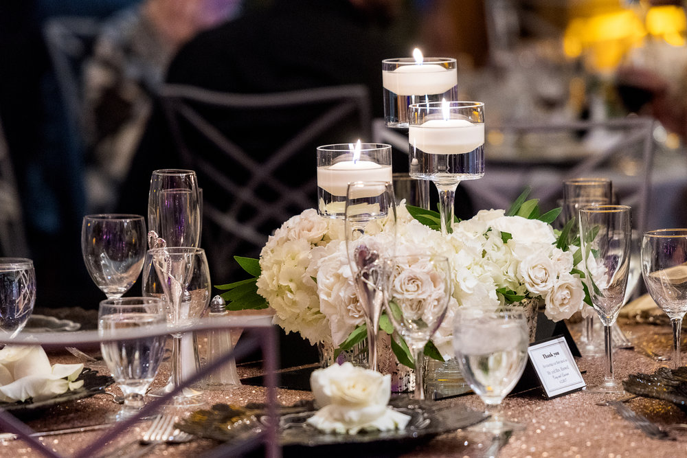Centerpieces of white and candels. Las Vegas Wedding Planner Andrea Eppolito.  Photo by Studio JK.
