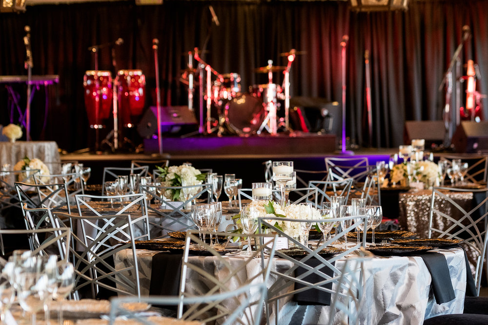 Band and stage in blush and black wedding.