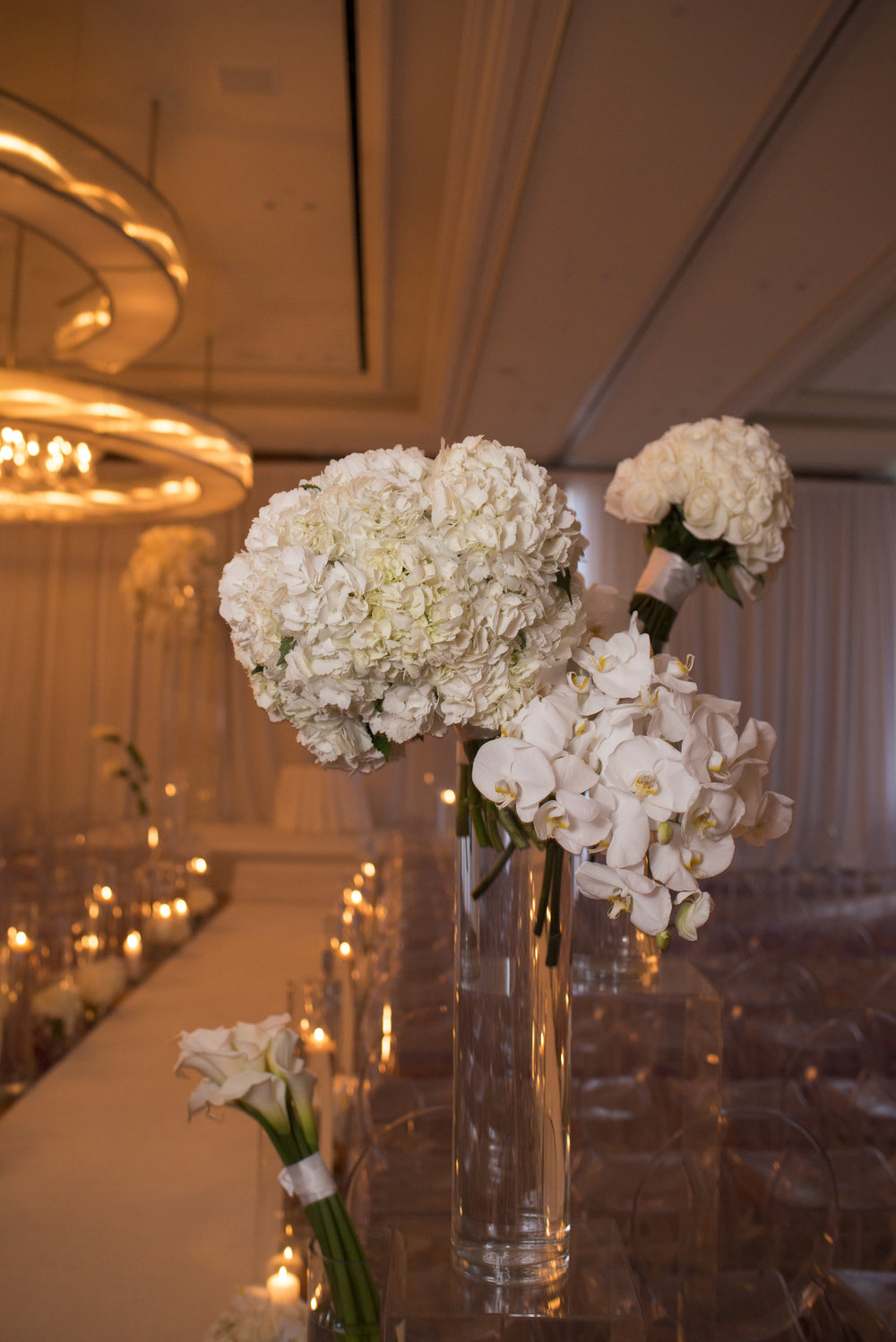ivory wedding at the mandarin oriental.  WEDDING PLANNING & EVENT DESIGN •  Andrea Eppolito Events , PHOTOGRAPHY •  AltF Photography ,  FLORAL AND DECOR DESIGN & PRODUCTION • Destinations by Design , CATERING •  Mandarin Oriental Las Vegas , COCKTAILS •  The Grand Bevy , WEDDING GOWN •  Galia Lahav ,  SHOES •  Jimmy Choo