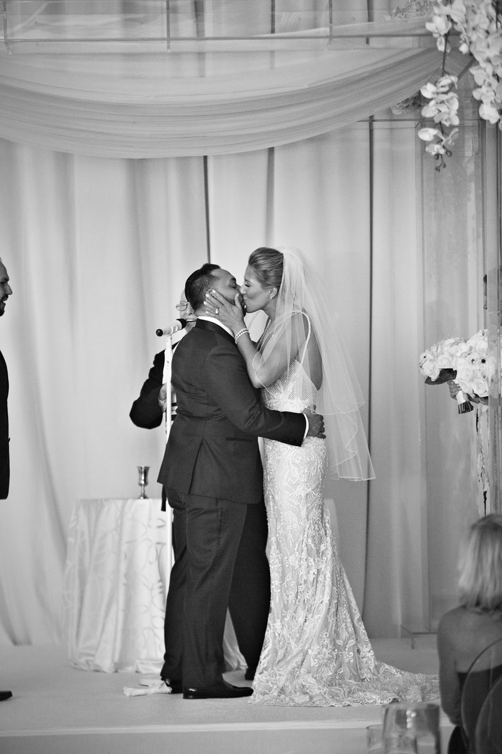 The first kiss.  WEDDING PLANNING & EVENT DESIGN •  Andrea Eppolito Events , PHOTOGRAPHY •  AltF Photography ,  FLORAL AND DECOR DESIGN & PRODUCTION • Destinations by Design , CATERING •  Mandarin Oriental Las Vegas , COCKTAILS •  The Grand Bevy , WEDDING GOWN •  Galia Lahav ,  SHOES •  Jimmy Choo