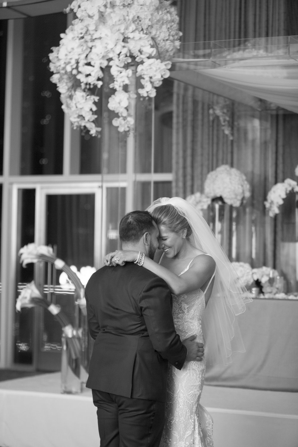 First dance for bride and groom in black and white. WEDDING PLANNING & EVENT DESIGN •  Andrea Eppolito Events , PHOTOGRAPHY •  AltF Photography ,  FLORAL AND DECOR DESIGN & PRODUCTION • Destinations by Design , CATERING •  Mandarin Oriental Las Vegas , COCKTAILS •  The Grand Bevy , WEDDING GOWN •  Galia Lahav ,  SHOES •  Jimmy Choo , ACRYLIC MENUS & SEATING CHART•  She Paperie