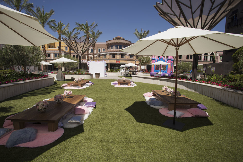 Bistro umbrellas for share in the summer sun for the guests. Celebrity Event Planner Andrea Eppolito.  Floral and Rentals by Destinations by Design. Photo by Triple Vision Studios.