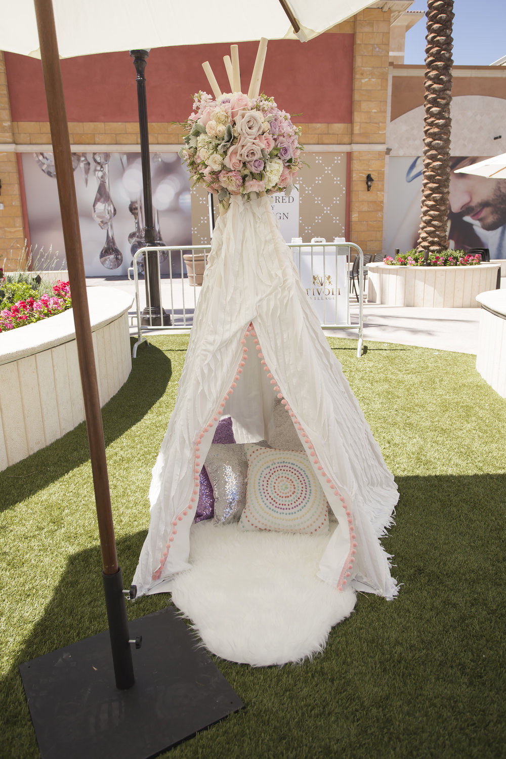 Individual teepee trimmed with fur and topped with pastel roses for Azari's first birthday party. Celebrity Event Planner Andrea Eppolito.  Floral and Rentals by Destinations by Design. Photo by Triple Vision Studios.