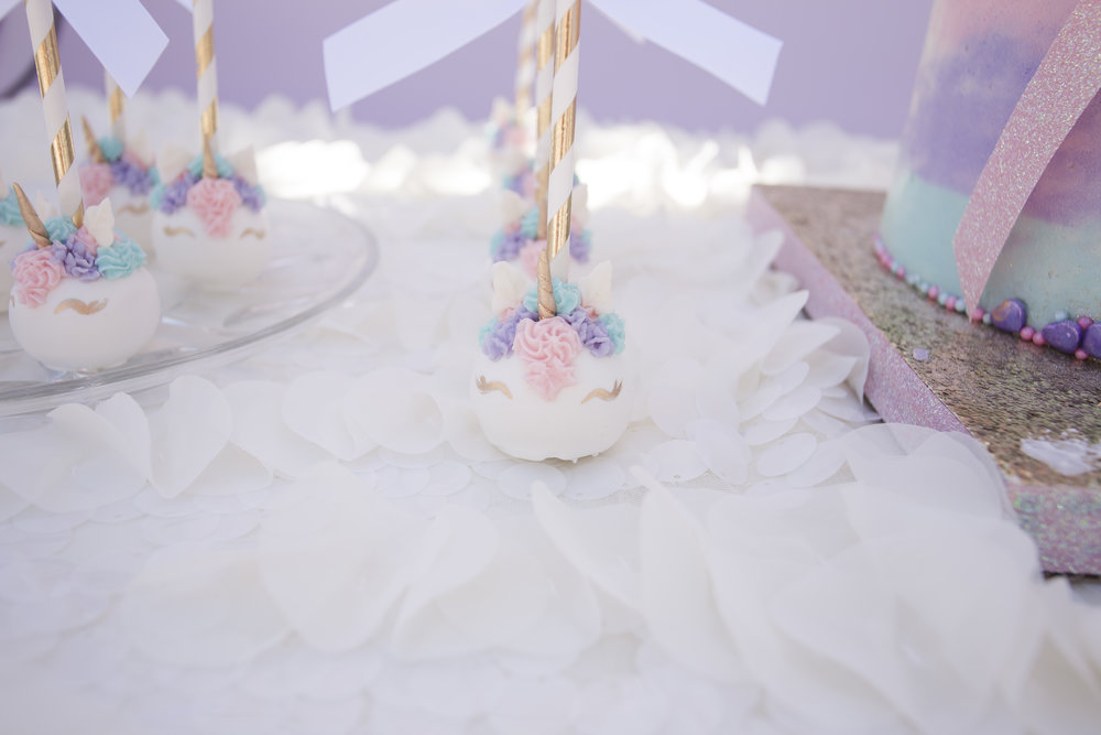 Unicorn cake pops in white, pastels, and gold.  Celebrity Event Planner Andrea Eppolito.  Floral and Rentals by Destinations by Design. Photo by Triple Vision Studios.