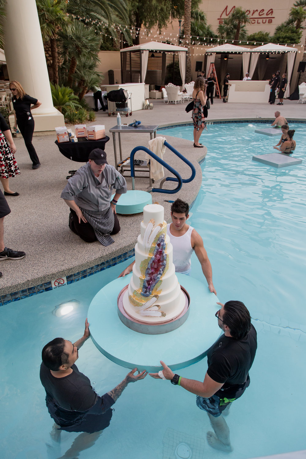 Behind the Scenes - How do you float a wedding cake? Destination Wedding Planner  Andrea Eppolito  · Photos by  Adam Frazier Photography  · Floral and Decor by  Destinations by Design  ·  Lighting by  LED Unplugged  · Venue  · Invitations  Ceci New York   ·  Menus by  Alligator Soup