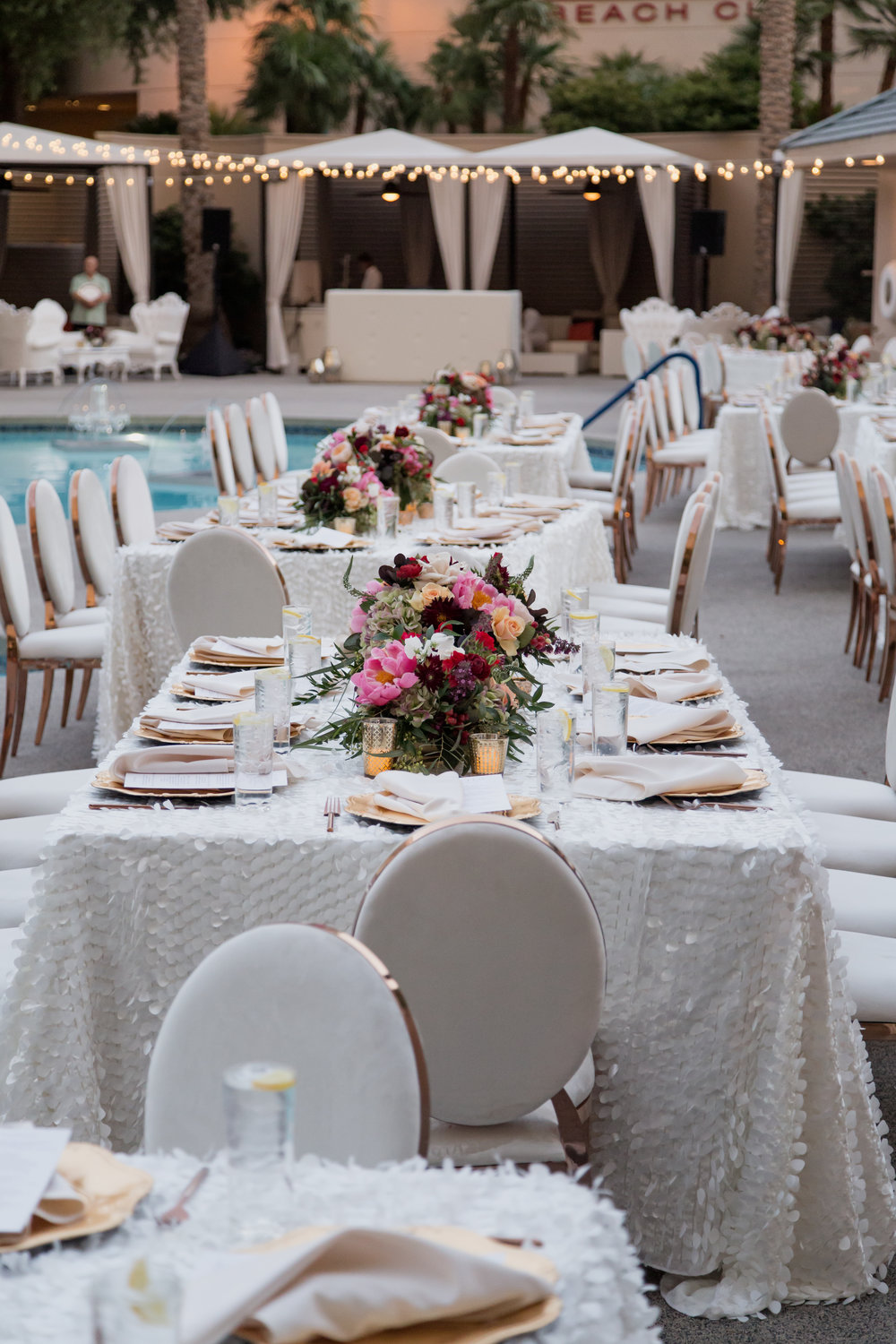 White and jewel toned pool side wedding. Destination Wedding Planner  Andrea Eppolito  · Photos by  Adam Frazier Photography  · Floral and Decor by  Destinations by Design  ·  Lighting by  LED Unplugged  · Venue  · Invitations  Ceci New York   ·  Menus by  Alligator Soup