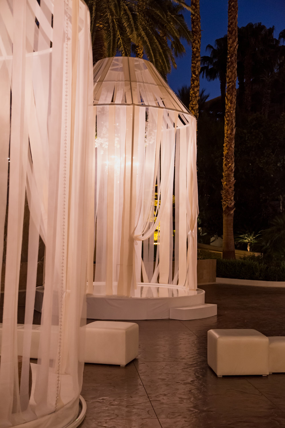 Oversized birdcages lit at night.  Destination Wedding Planner  Andrea Eppolito  · Photos by  Adam Frazier Photography  · Floral and Decor by  Destinations by Design  ·  Lighting by  LED Unplugged  · Venue  · Invitations  Ceci New York   ·  Menus by  Alligator Soup