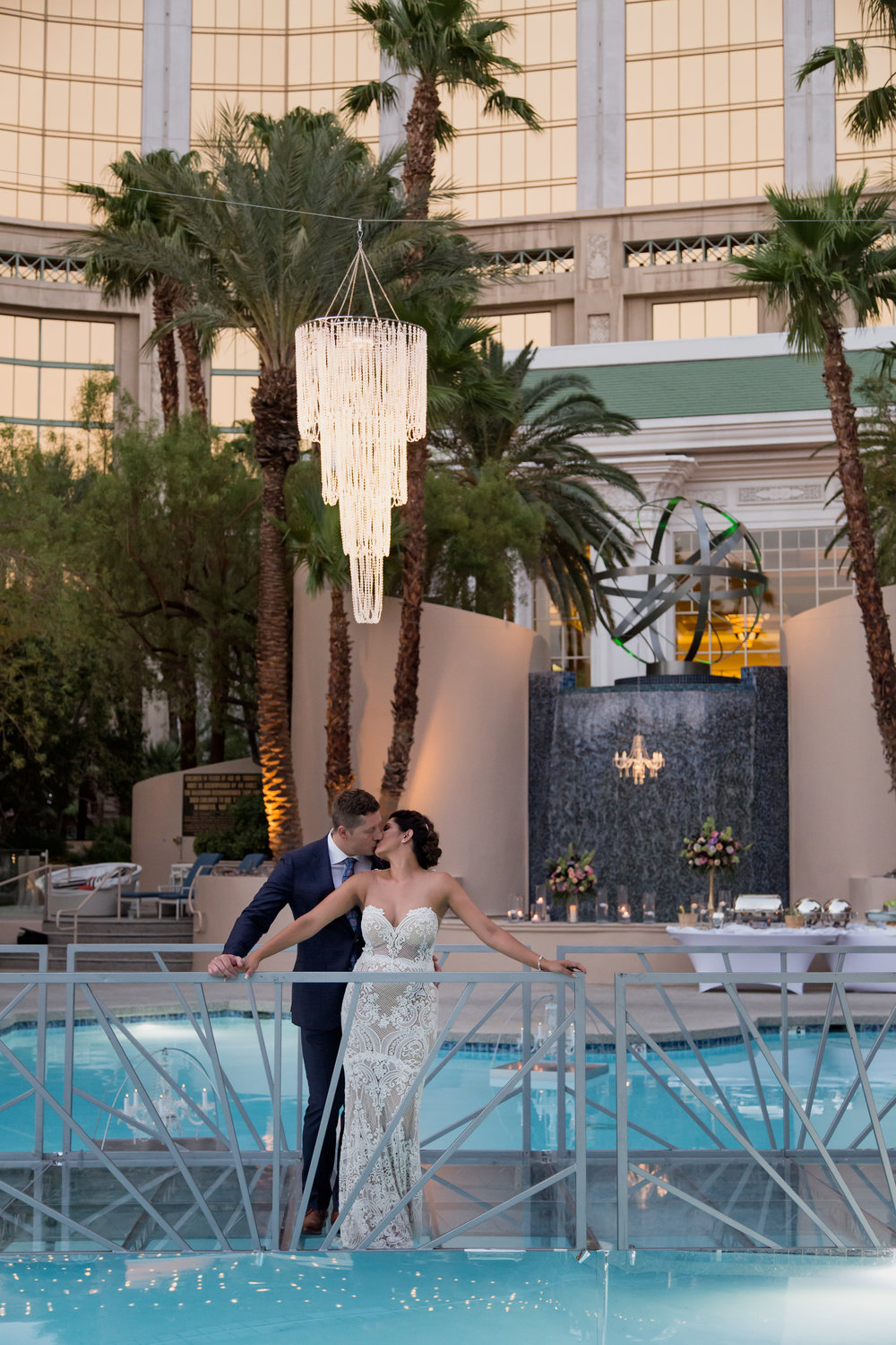 Joti & Field rave about Destination Wedding Planner Andrea Eppolito. Luxury wedding at Four Seasons included floating cake, chandeliers, and more! Photo by Stephen Salazar.