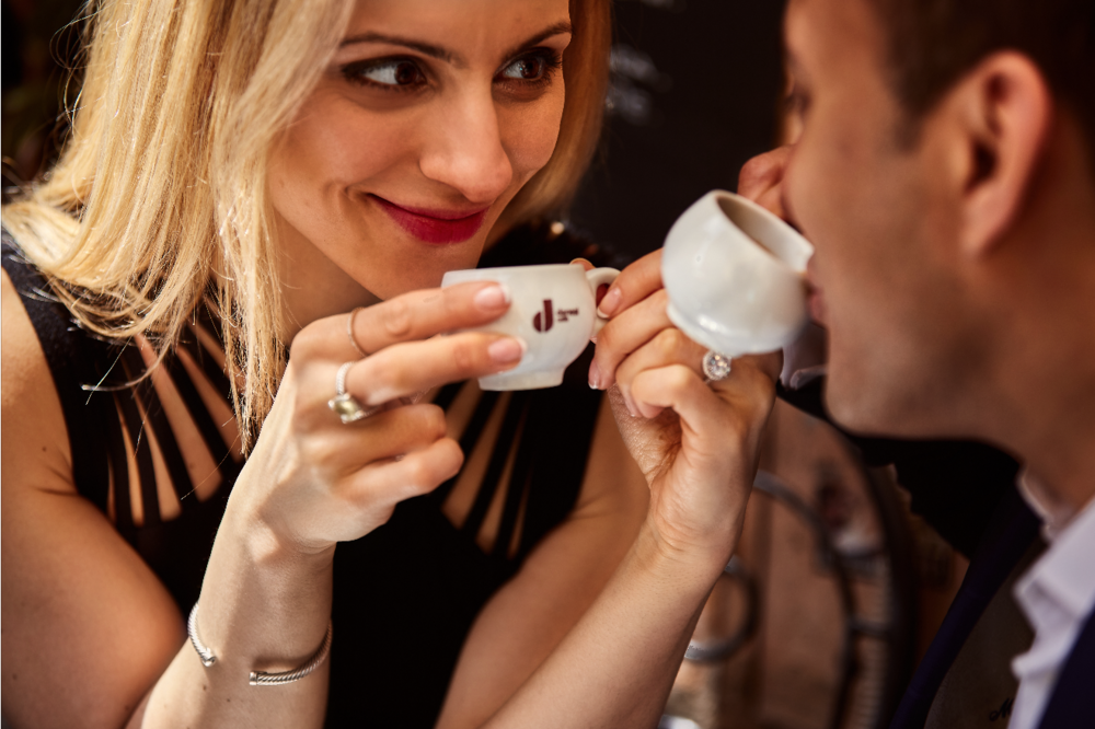 Espresso in Tuscan Cafe. Destination wedding planner Andrea Eppolito. Engagement photos in Italy.   Italian Imagery by D2 Photography.