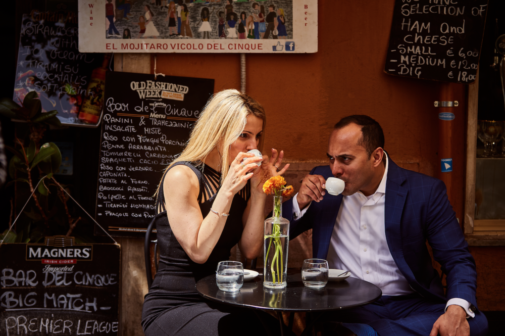 Engagement photos in coffee cafe.  Destination wedding planner Andrea Eppolito. Engagement photos in Italy.   Italian Imagery by D2 Photography.