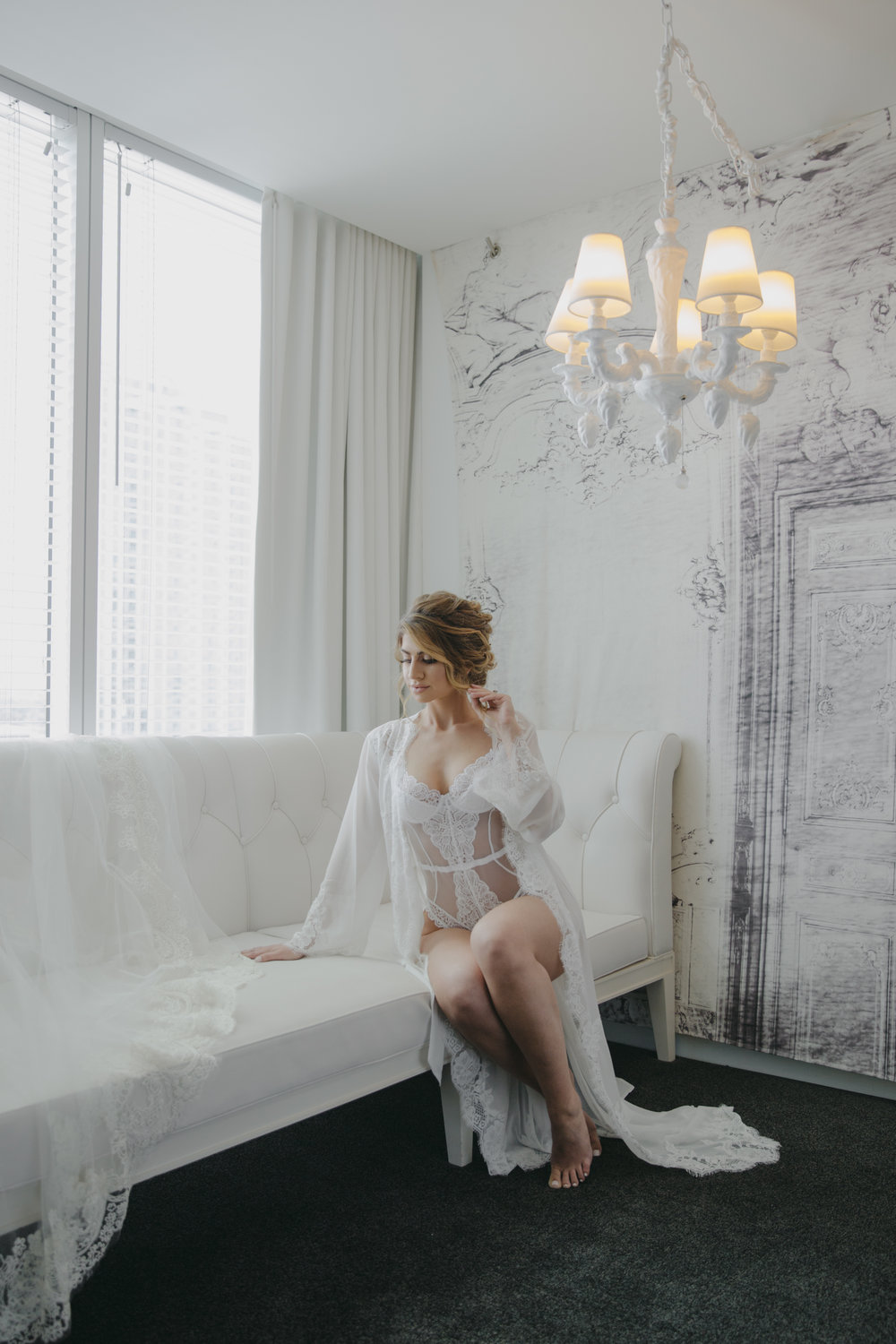 Luxury Destination Wedding Planning and Event Design by  Andrea Eppolito Events  · Photos by  Stephen Salazar  · Bride in white lace negligee.  Boudoure shoot.