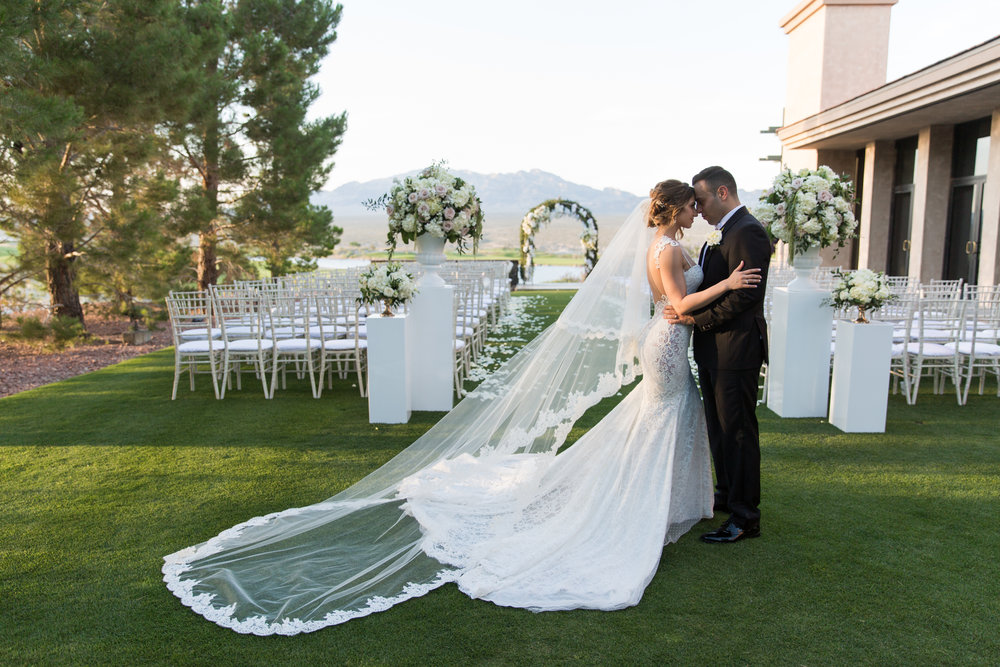 Newlyweds at glamorous and romantic outdoor wedding. Luxury Destination Wedding Planning and Event Design by  Andrea Eppolito Events  · Photos by  Stephen Salazar  · Flowers by  Naakiti Floral  ·  Rentals by RSVP · Lighting by  LED Unplugged   · Venue  Paiute Golf Course .  Dress by  Berta  · Shoes by  Jimmy Choo