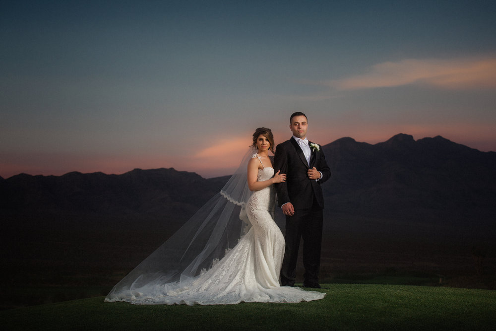 Bride and groom wedding portrait at sunset in Las Vegas.  Luxury Destination Wedding Planning and Event Design by  Andrea Eppolito Events  · Photos by  Stephen Salazar  · Flowers by  Naakiti Floral  ·  Rentals by RSVP · Lighting by  LED Unplugged   · Venue  Paiute Golf Course .  Dress by  Berta  · Shoes by  Jimmy Choo
