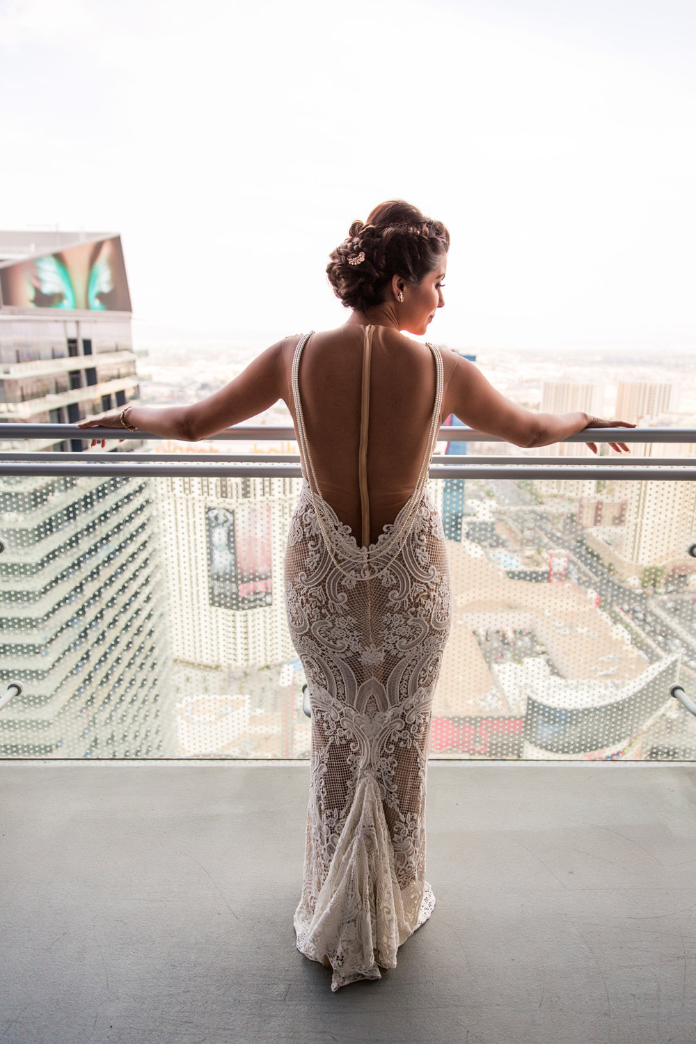 Bride on balcony, waiting.  Wedding Planning by  Andrea Eppolito Events   ·  Photography by  Shandro Photo    ·  Wedding Venue  Four Seasons Las Vegas   ·  Floral and Decor by  Destination by Design   ·  Chandeliers and Lighting by  LED Unplugged