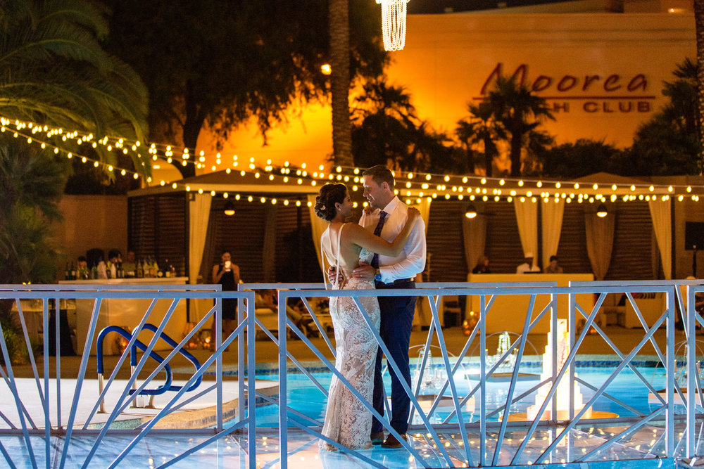 First dance on floating bridge over pool. First dance on bridge over pool. Jewel toned wedding centerpieces with gold accents. Wedding Planning by  Andrea Eppolito Events   ·  Photography by  Shandro Photo    ·  Wedding Venue  Four Seasons Las Vegas   ·  Floral and Decor by  Destination by Design   ·  Cake by  Four Seasons Las Vegas   ·  Chandeliers and Lighting by  LED Unplugged   ·  Dress by  Berta   and Menu by Alligator Soup