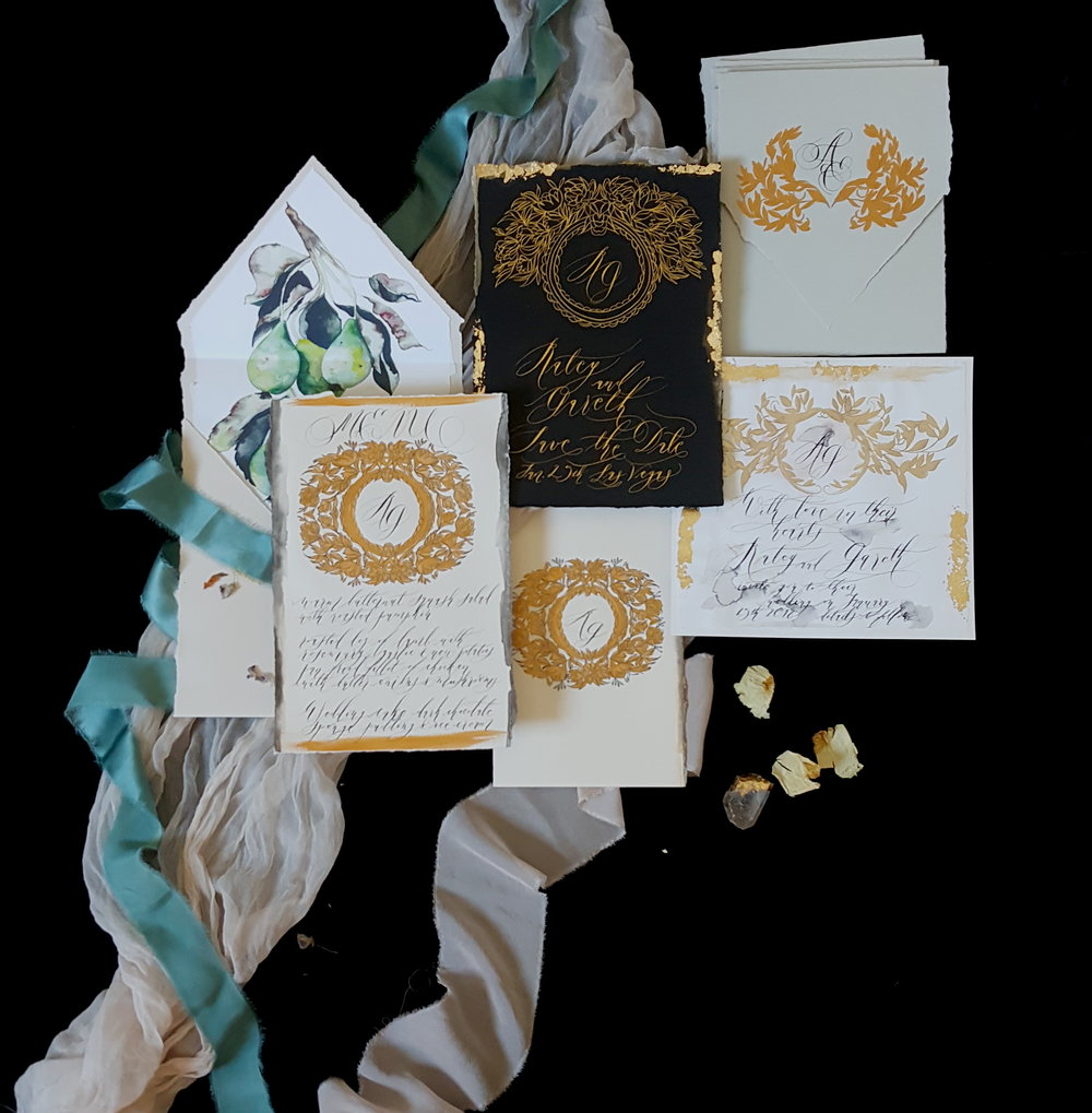 Luxe invitations are hand painted in gold and black on ivory paper.  Created by Crimson Letters.  Las Vegas Wedding Planner www.AndreaEppolitoEvents.com