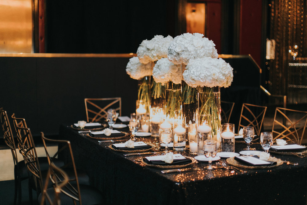 Long Black Tables Topped with White Hydrangea and Candles