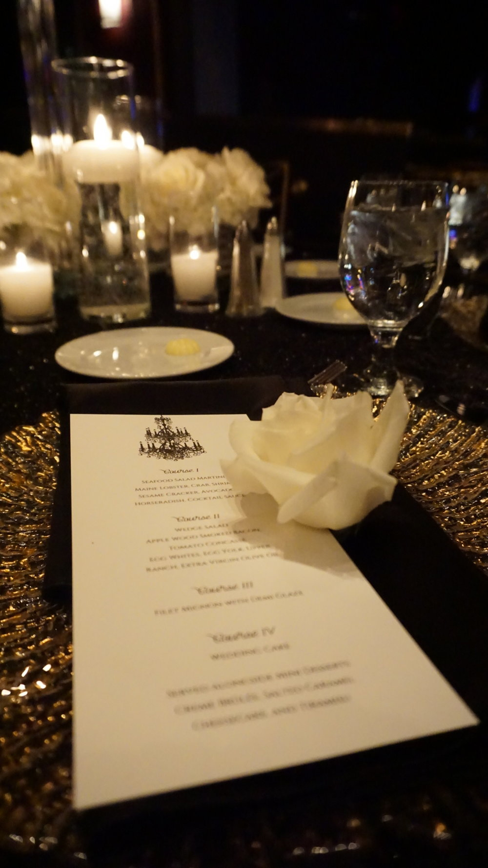Long White Menu on Black Napkin