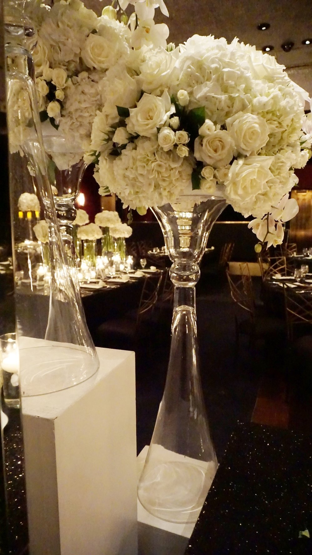Roses and hydrangea and orchid centerpieces