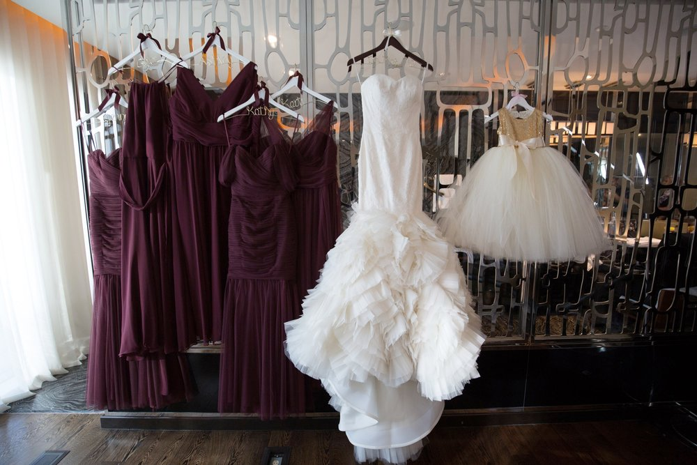 Burgundy Bridesmaid Dresses with Vera Wang Wedding Dress.  Luxury wedding at the Mandarin Oriental with a color scheme of white, blush, and pops of wine red produced by Las Vegas Wedding Planner Andrea Eppolito with photos by Stephen Salazar Photography.