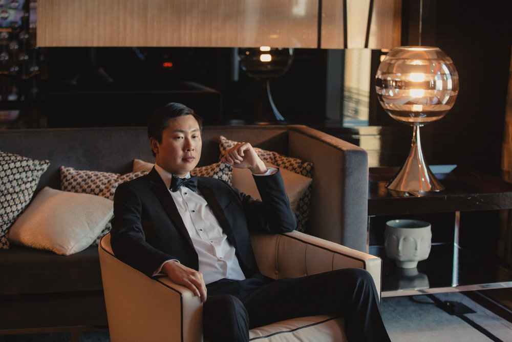 Groom in waiting.  Luxury wedding at the Mandarin Oriental with a color scheme of white, blush, and pops of wine red produced by Las Vegas Wedding Planner Andrea Eppolito with photos by Stephen Salazar Photography.