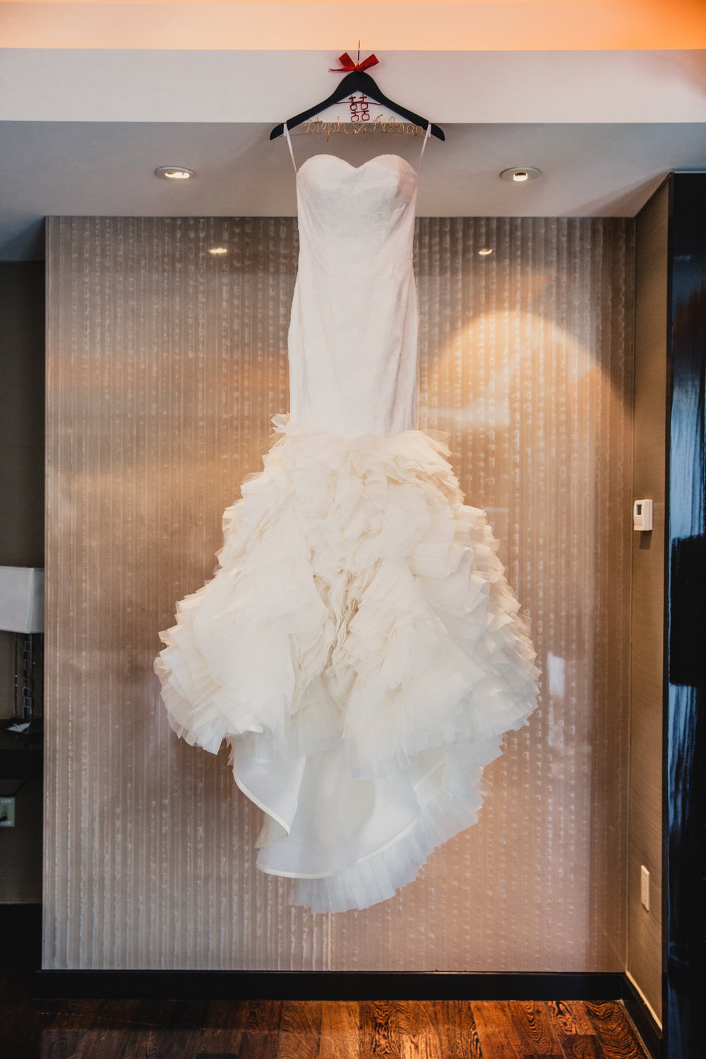 Vera Wang Wedding Dress.  Luxury wedding at the Mandarin Oriental with a color scheme of white, blush, and pops of wine red produced by Las Vegas Wedding Planner Andrea Eppolito with photos by Stephen Salazar Photography.