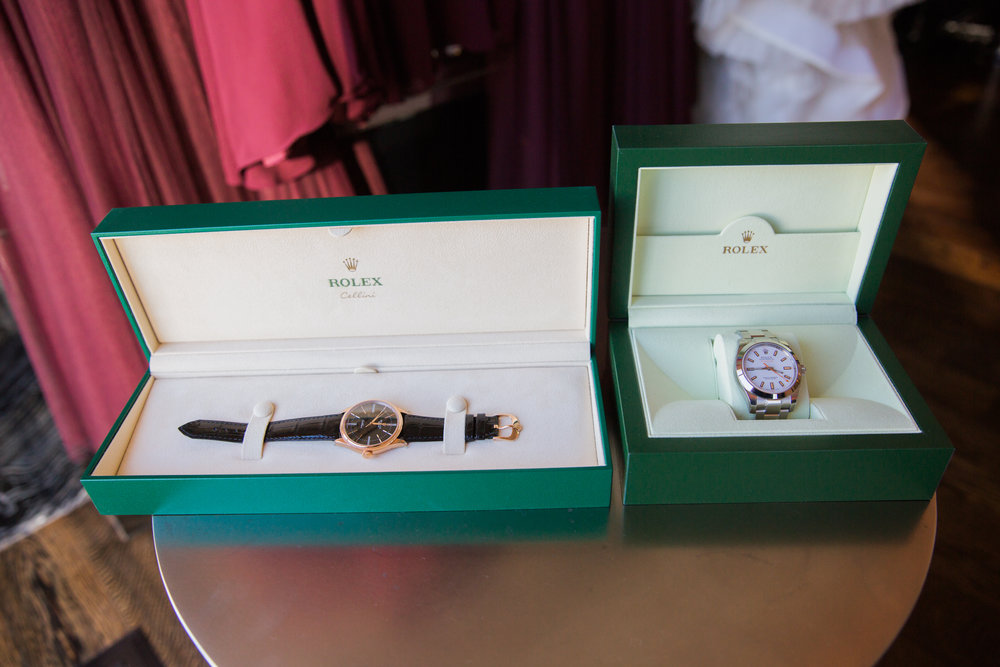Rolex Watches as Wedding Gift.  Luxury wedding at the Mandarin Oriental with a color scheme of white, blush, and pops of wine red produced by Las Vegas Wedding Planner Andrea Eppolito with photos by Stephen Salazar Photography.