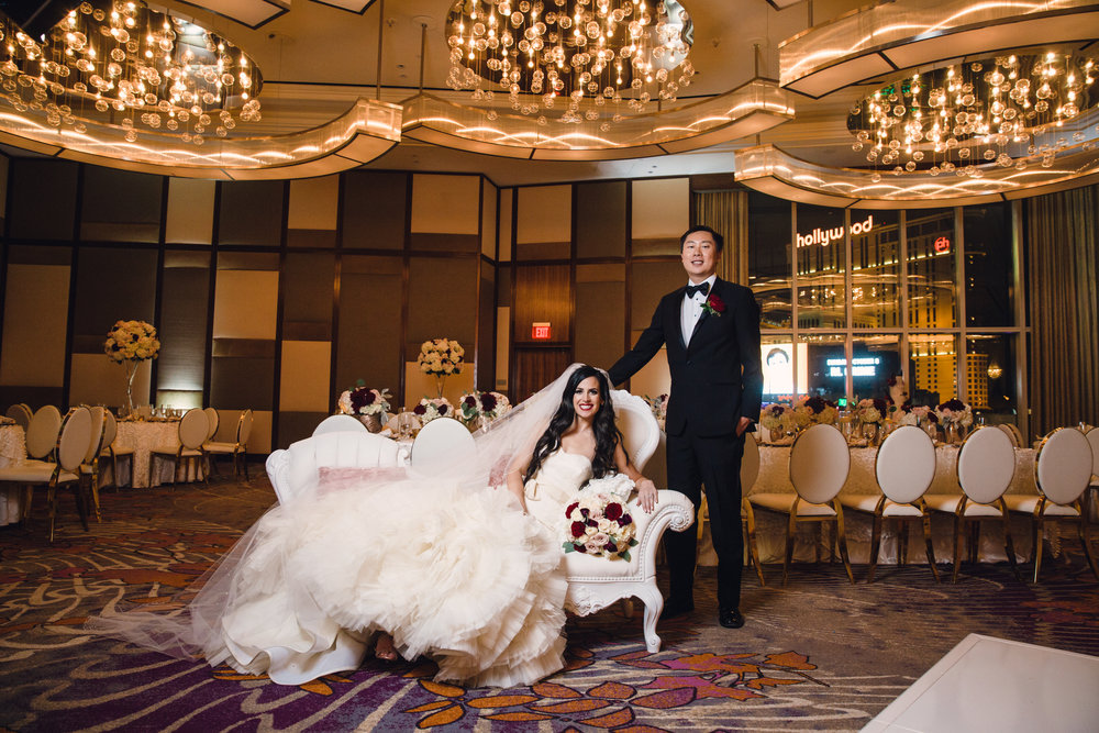 Bride and groom in ballroom. Luxury wedding at the Mandarin Oriental with a color scheme of white, blush, and pops of wine red produced by Las Vegas Wedding Planner Andrea Eppolito with photos by Stephen Salazar Photography.