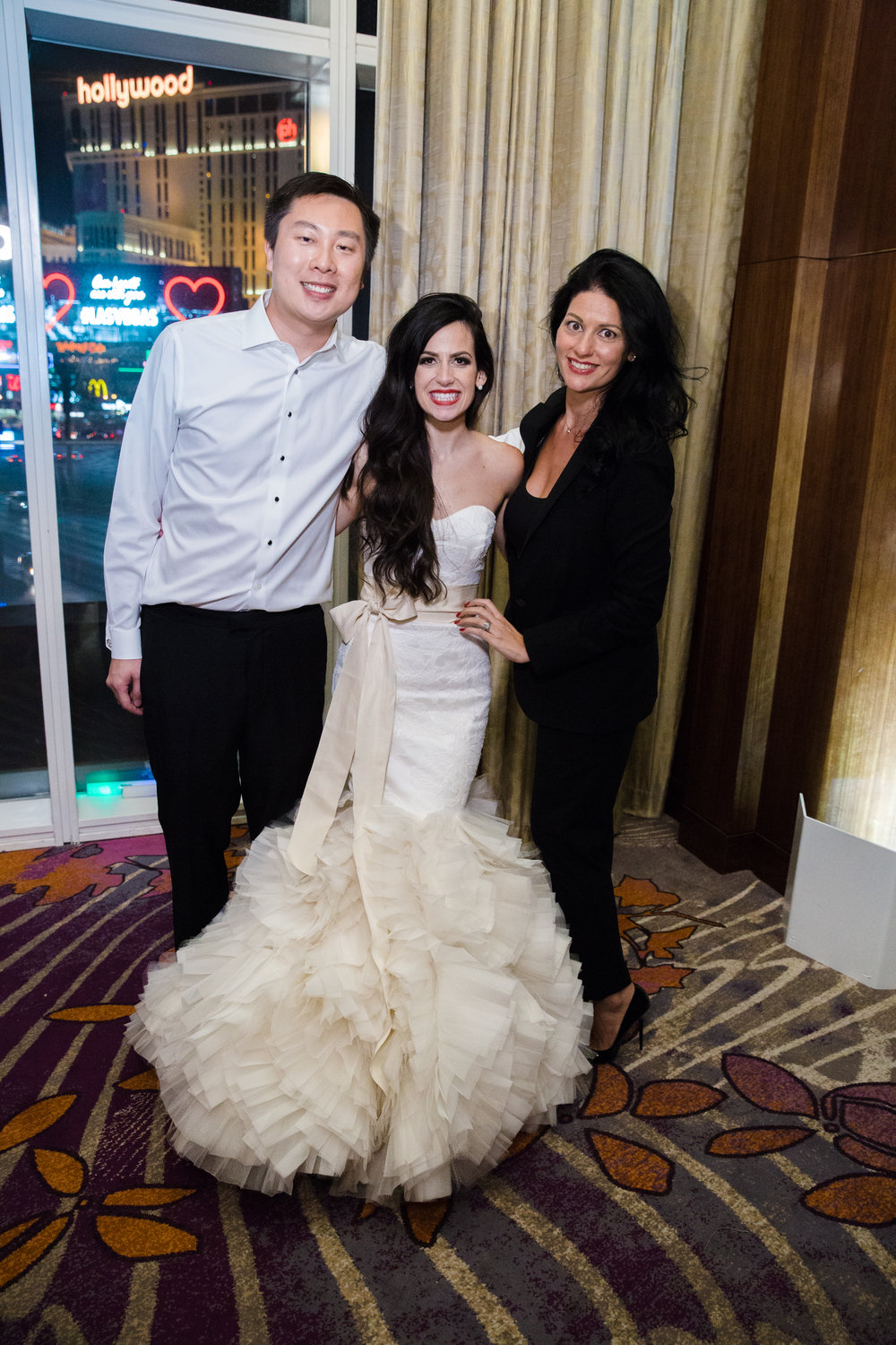 Las Vegas Wedding Planner Andrea Eppolito with bride and Groom.  Luxury wedding at the Mandarin Oriental with a color scheme of white, blush, and pops of wine red produced by Las Vegas Wedding Planner Andrea Eppolito with photos by Stephen Salazar Photography.