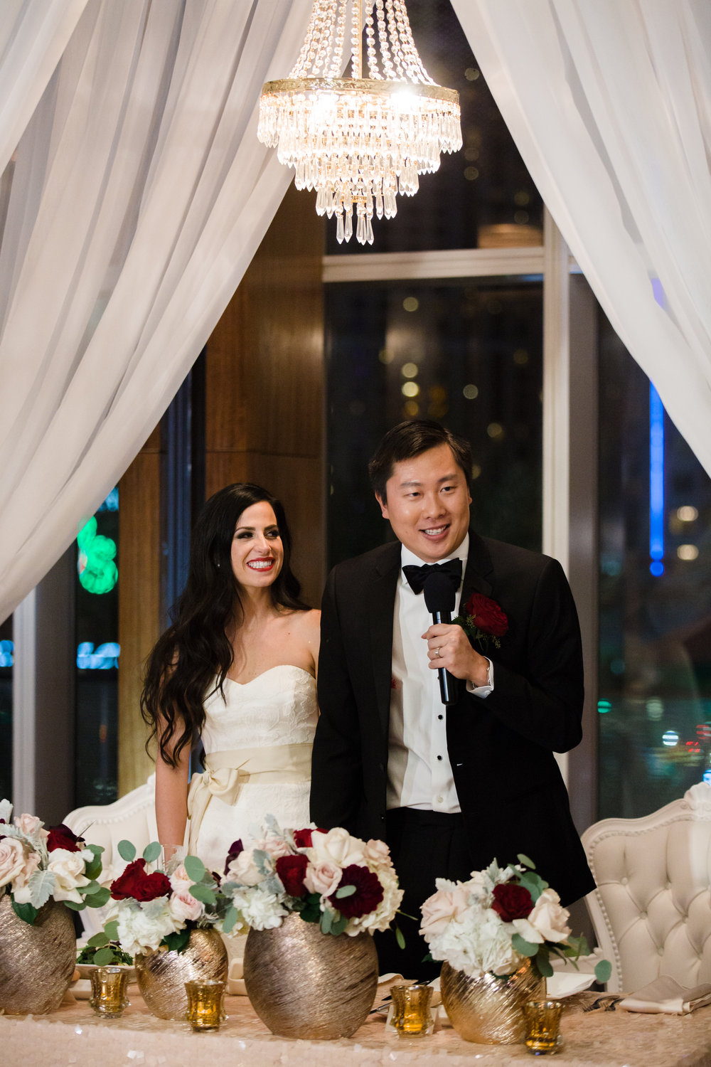 Thank you toast from the bride and groom.  Luxury wedding at the Mandarin Oriental with a color scheme of white, blush, and pops of wine red produced by Las Vegas Wedding Planner Andrea Eppolito with photos by Stephen Salazar Photography.