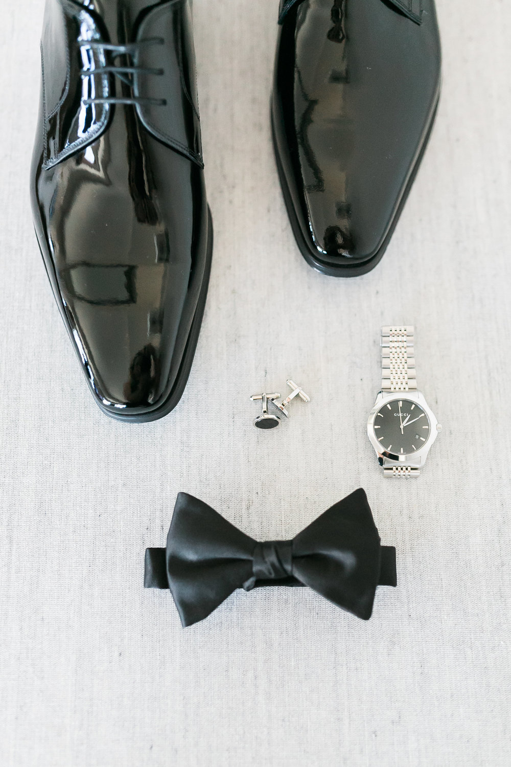 The groom wore shiny black patent leather shoes and a bow tie for a classic black tie look.  Las Vegas Wedding Planner Andrea Eppolito shares this multicultural wedding.  Photo by J.Anne Photography.