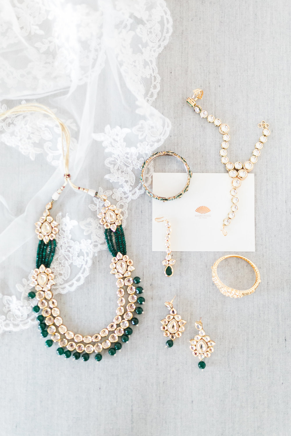 The family adorned the bride with gold and green indian wedding jewelry.  These pieces are opulent jewels that will be passed on and worn for years.  Las Vegas Wedding Planner Andrea Eppolito shares this multicultural wedding.  Photo by J.Anne Photography.