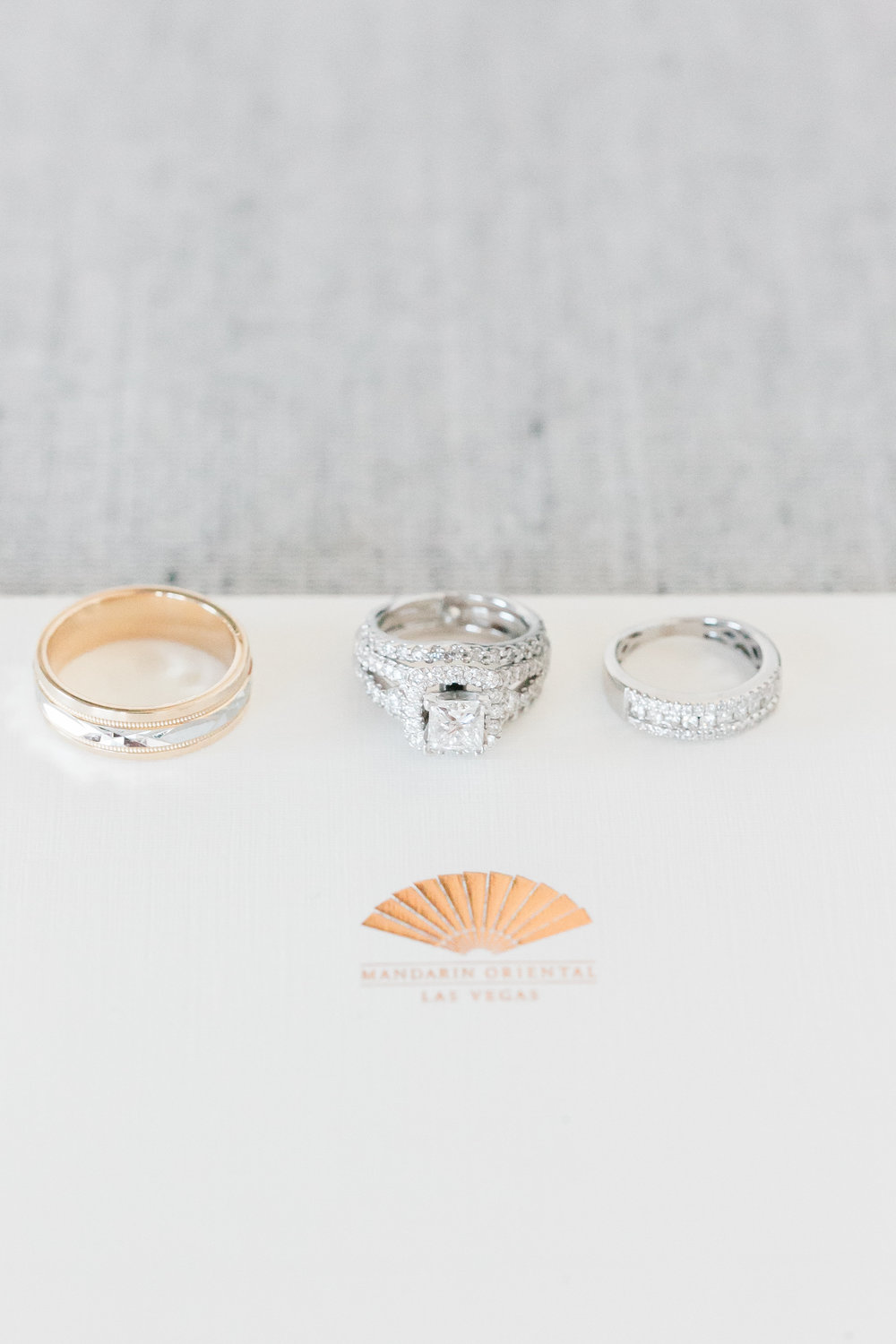 Engagement ring and wedding bands.  A halo ring with an eternity band was a perfect fit for our bride, while the groom went with Indian gold.  Las Vegas Wedding Planner Andrea Eppolito shares this multicultural wedding.  Photo by J.Anne Photography.