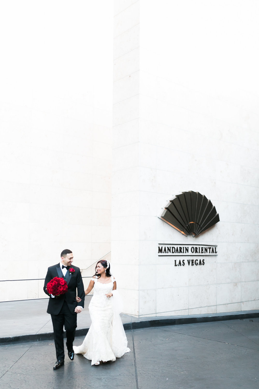Bride and groom at their hotel reception.   Las Vegas Wedding Planner Andrea Eppolito shares this multicultural wedding.  Photo by J.Anne Photography. Wedding at Mandarin Oriental Las Vegas,