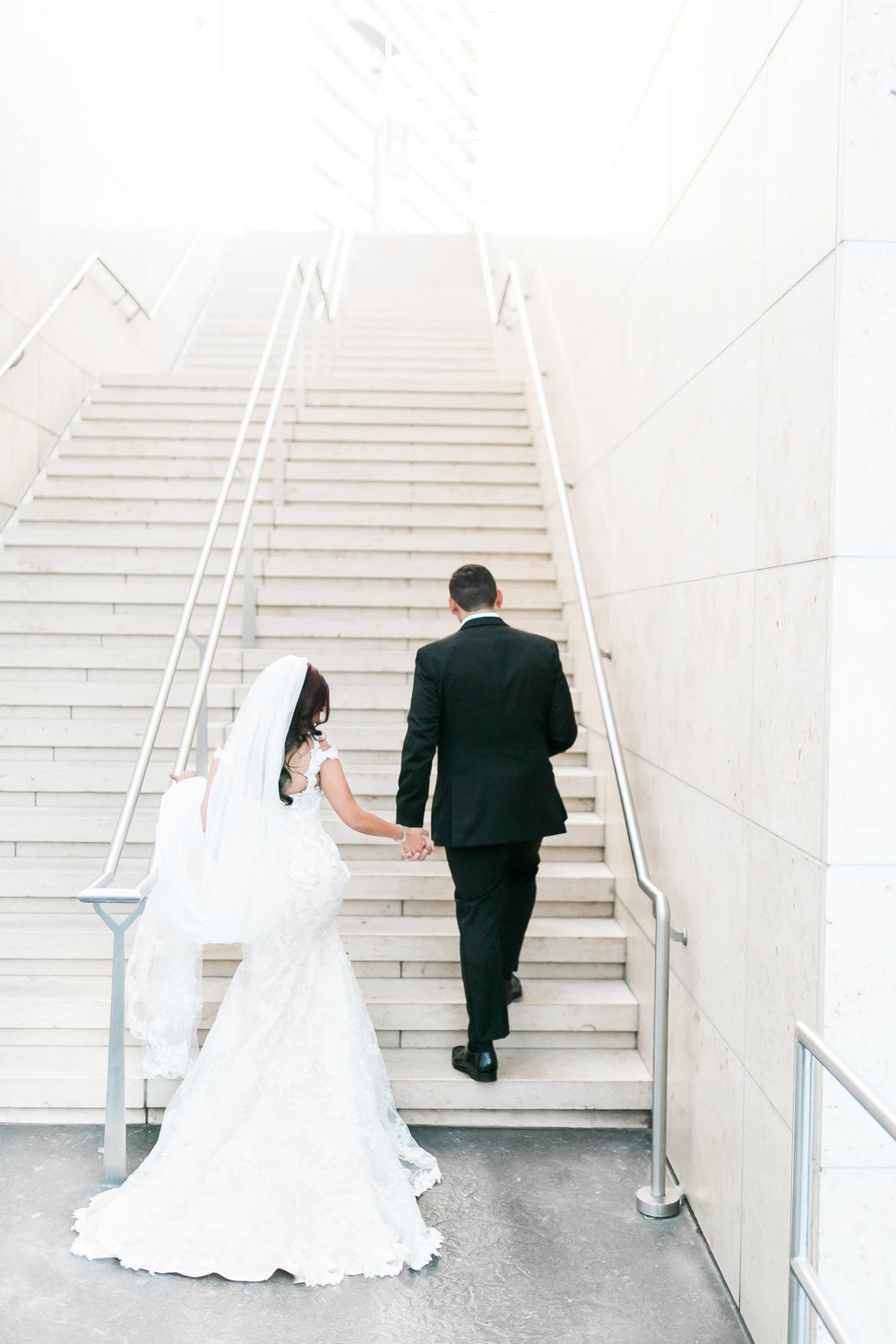 Stairway to heaven wedding photo.   Las Vegas Wedding Planner Andrea Eppolito shares this multicultural wedding.  Photo by J.Anne Photography. Wedding at Mandarin Oriental Las Vegas,  Dress by Maggie Sottero.