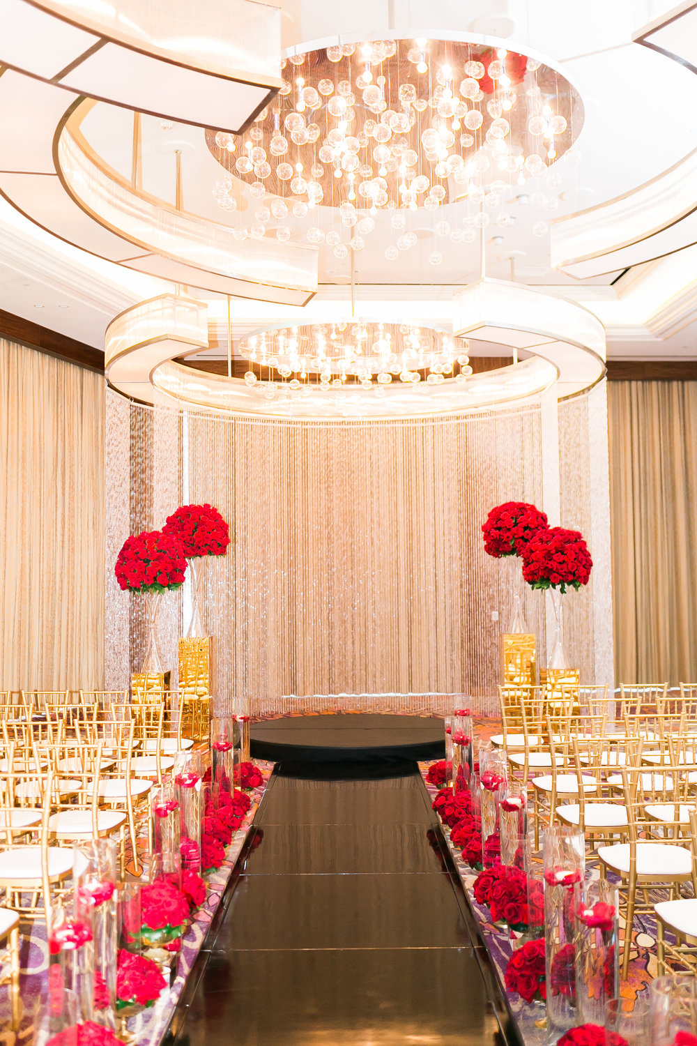 Glamorous red, gold, and black wedding ceremony.   Las Vegas Wedding Planner Andrea Eppolito shares this multicultural wedding.  Photo by J.Anne Photography. Wedding at Mandarin Oriental Las Vegas.  Floral and Decor by DBD Vegas.