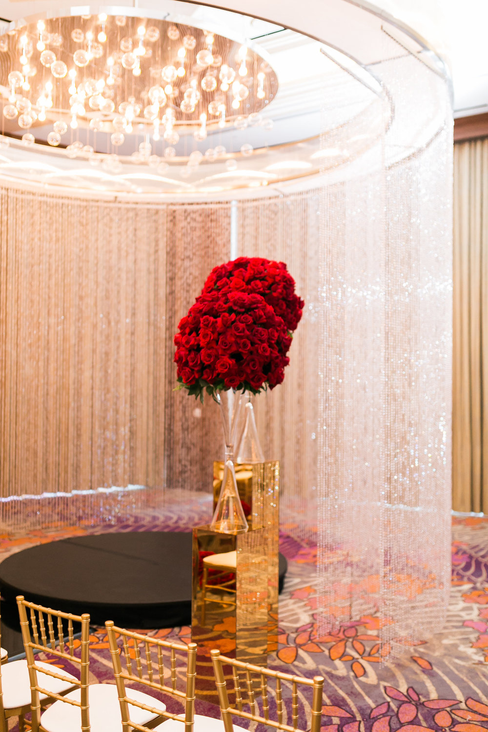 Deep red roses for the ceremony alter.   Las Vegas Wedding Planner Andrea Eppolito shares this multicultural wedding.  Photo by J.Anne Photography. Wedding at Mandarin Oriental Las Vegas.  Decor by DBD Vegas.