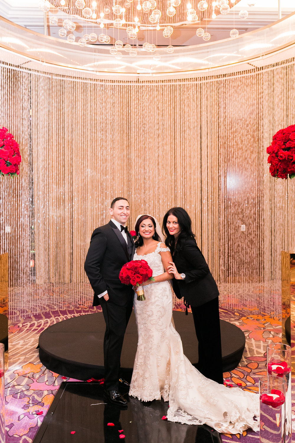 Bride and groom with their wedding planner.  Las Vegas Wedding Planner Andrea Eppolito shares this multicultural wedding.  Photo by J.Anne Photography. Wedding at Mandarin Oriental Las Vegas.  Decor by DBD Vegas.