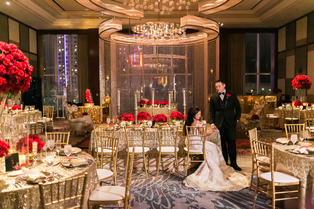 Bride and groom share a moment in their stunning reception.  This wedding was all about drama and glamour.  Las Vegas Wedding Planner Andrea Eppolito shares this multicultural wedding.  Photo by J.Anne Photography. Wedding at Mandarin Oriental Las Vegas.  Decor by DBD Vegas.