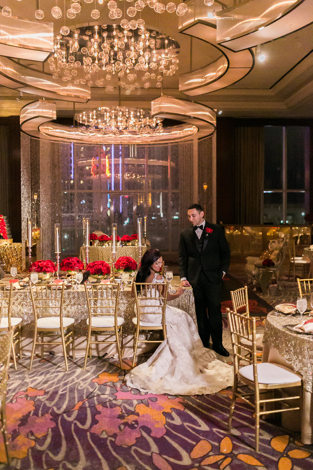 Bride and groom taking a moment for themselves before their guests enter. Las Vegas Wedding Planner Andrea Eppolito shares this multicultural wedding.  Photo by J.Anne Photography. Wedding at Mandarin Oriental Las Vegas.  Decor by DBD Vegas.