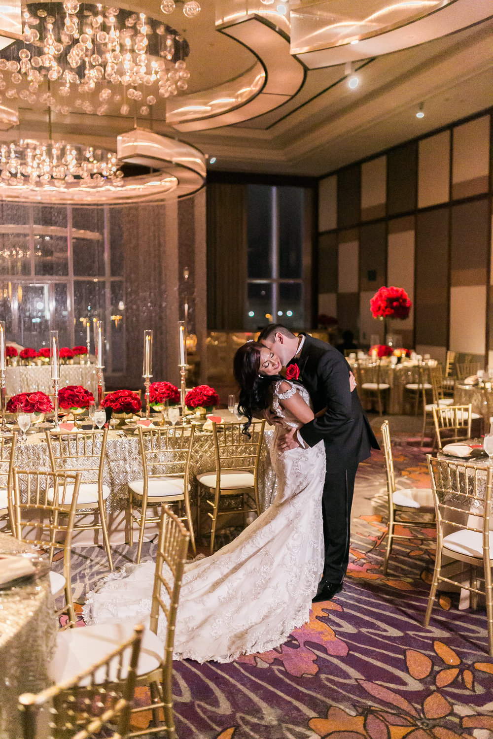 The groom plants a kiss on the bride's neck. Las Vegas Wedding Planner Andrea Eppolito shares this multicultural wedding.  Photo by J.Anne Photography. Wedding at Mandarin Oriental Las Vegas.  Decor by DBD Vegas.