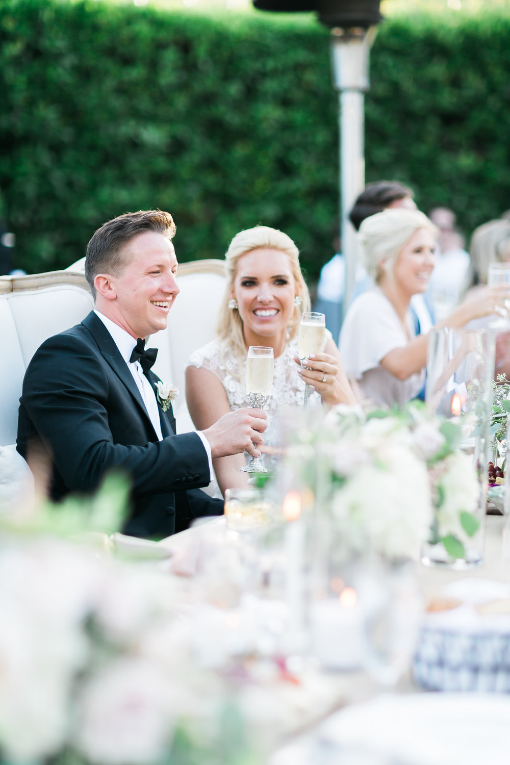 A toast to the newlyweds.  Destination Wedding Planner  ANDREA EPPOLITO EVENTS  · Images by  J.ANNE P  HOTOOGRAPHY  · Video  HOO FILMS  · Venue Ritz Carlton Bacara Santa Barbara