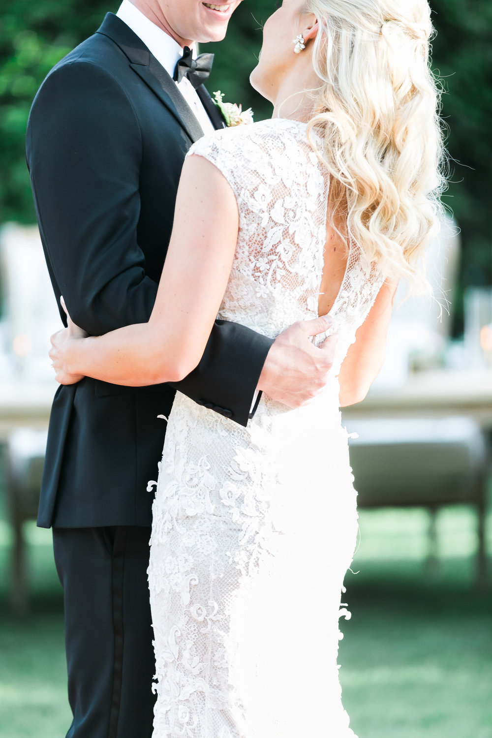 The first dance gave guests a chance to really see the beautiful lace detail on the bride's wedding dress.     Destination Wedding Planner  ANDREA EPPOLITO EVENTS  · Images by  J.ANNE P  HOTOOGRAPHY  · Video  HOO FILMS  · Venue Ritz Carlton Bacara Santa Barbara ·Gown MONIQUE LHULLIER