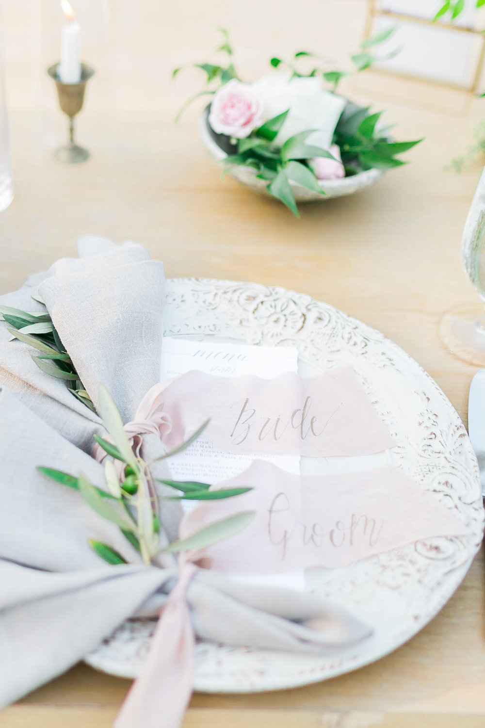 Napkins were tied with long blush ribbons that had the guest's name calligraphic on them.     Destination Wedding Planner  ANDREA EPPOLITO EVENTS  · Images by  J.ANNE P  HOTOOGRAPHY  · Video  HOO FILMS  · Venue Ritz Carlton Bacara Santa Barbara ·Gown MONIQUE LHULLIER ·Bridesmaids Dresses  SHOW ME YOUR MUMU ·Stationery  SHE PAPERIE ·Bride's Shoes  BADGLEY MISCHKA ·Hair and Makeup  TEAM HAIR AND MAKEUP · Floral  BLUE MAGNOLIA ·Linen  LA TAVOLA ·Decor Rentals  TENT MERCHANT ·Calligraphy  EBB ·Lighting  FIVE STAR AV ·Ice Cream Station  MCCONNELL'S ICE CREAM