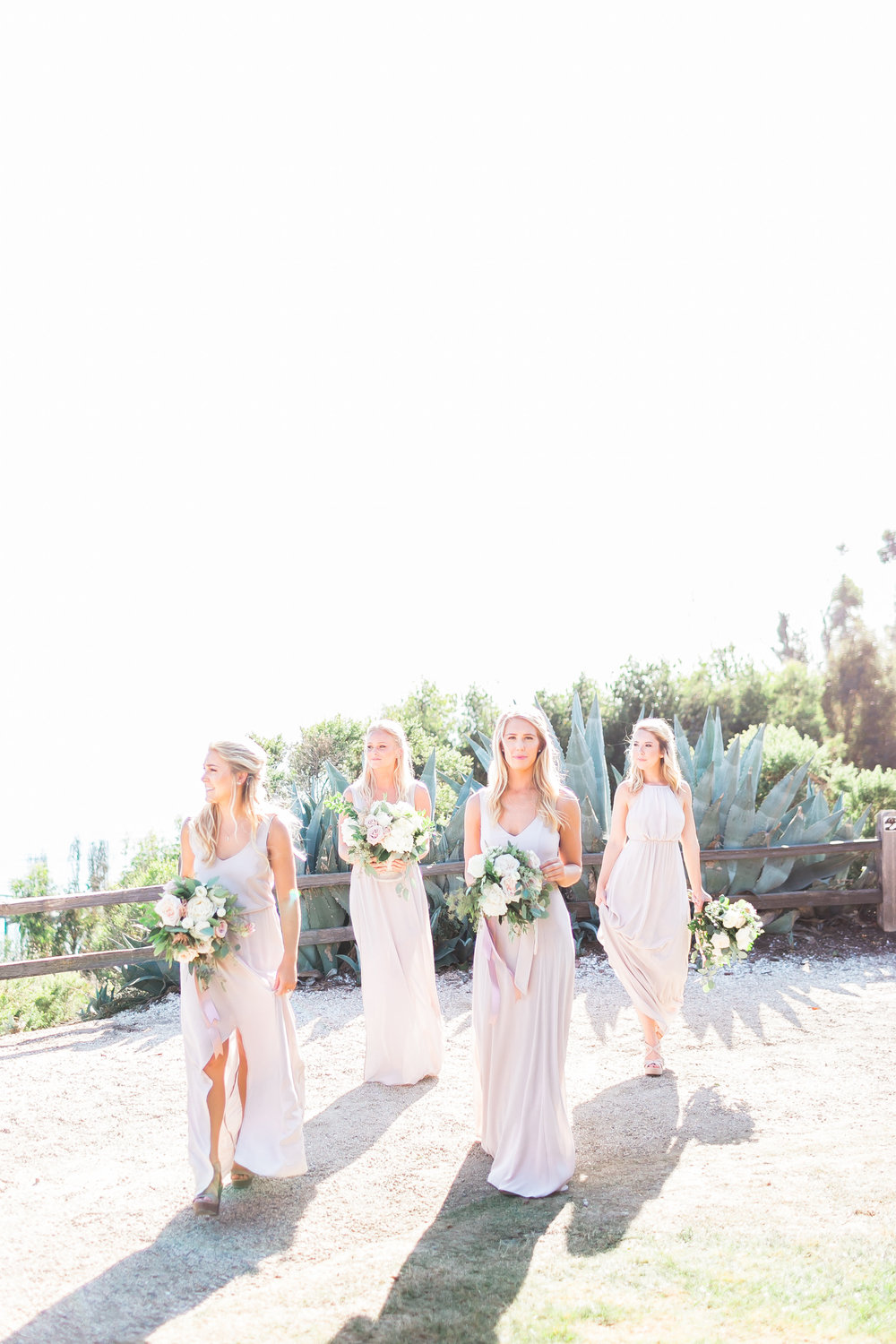The blondest bridesmaids you ever did see!     Destination Wedding Planner  ANDREA EPPOLITO EVENTS   ·  Images by  J.ANNE P  HOTOOGRAPHY   ·  Video  HOO FILMS   ·  Venue Ritz Carlton Bacara Santa Barbara  · Gown MONIQUE LHULLIER  · Bridesmaids Dresses  SHOW ME YOUR MUMU  · Stationery  SHE PAPERIE  · Bride's Shoes  BADGLEY MISCHKA  · Hair and Makeup  TEAM HAIR AND MAKEUP  · Floral  BLUE MAGNOLIA  · Linen  LA TAVOLA  · Decor Rentals  TENT MERCHANT  · Calligraphy  EBB  ·Lighting  FIVE STAR AV  · Ice Cream Station  MCCONNELL'S ICE CREAM