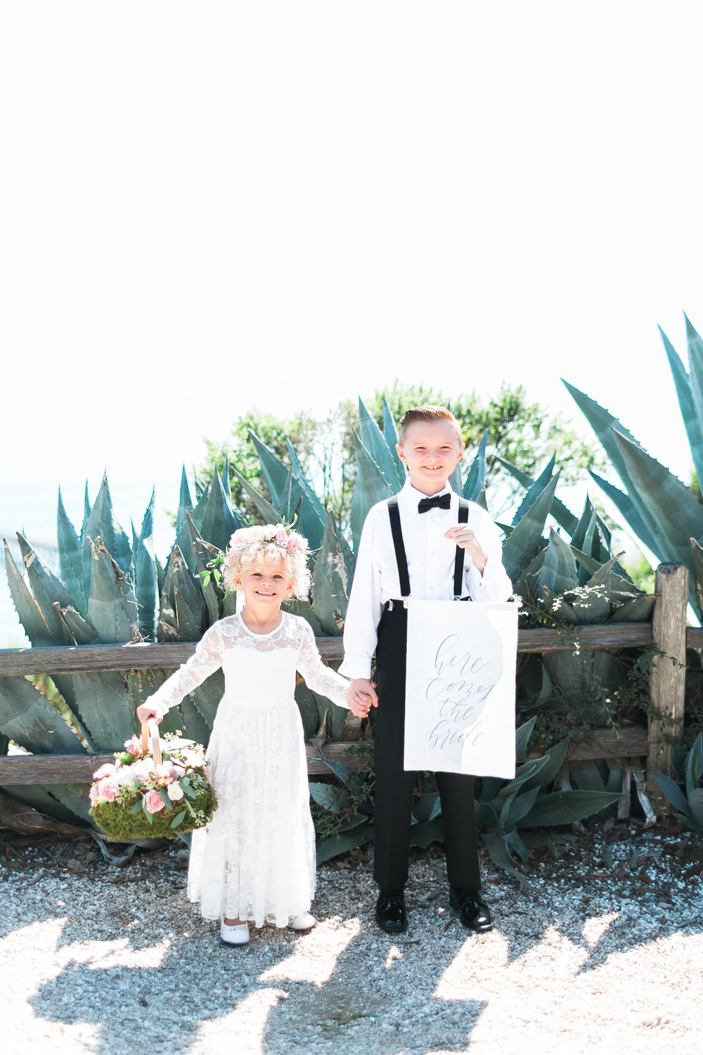 Adorable kids at wedding. Flower girl and ring bearer.    Destination Wedding Planner  ANDREA EPPOLITO EVENTS  · Images by  J.ANNE P  HOTOOGRAPHY  · Video  HOO FILMS  · Venue Ritz Carlton Bacara Santa Barbara ·Gown MONIQUE LHULLIER ·Bridesmaids Dresses  SHOW ME YOUR MUMU ·Stationery  SHE PAPERIE ·Bride's Shoes  BADGLEY MISCHKA ·Hair and Makeup  TEAM HAIR AND MAKEUP · Floral  BLUE MAGNOLIA ·Linen  LA TAVOLA ·Decor Rentals  TENT MERCHANT ·Calligraphy  EBB ·Lighting  FIVE STAR AV ·Ice Cream Station  MCCONNELL'S ICE CREAM