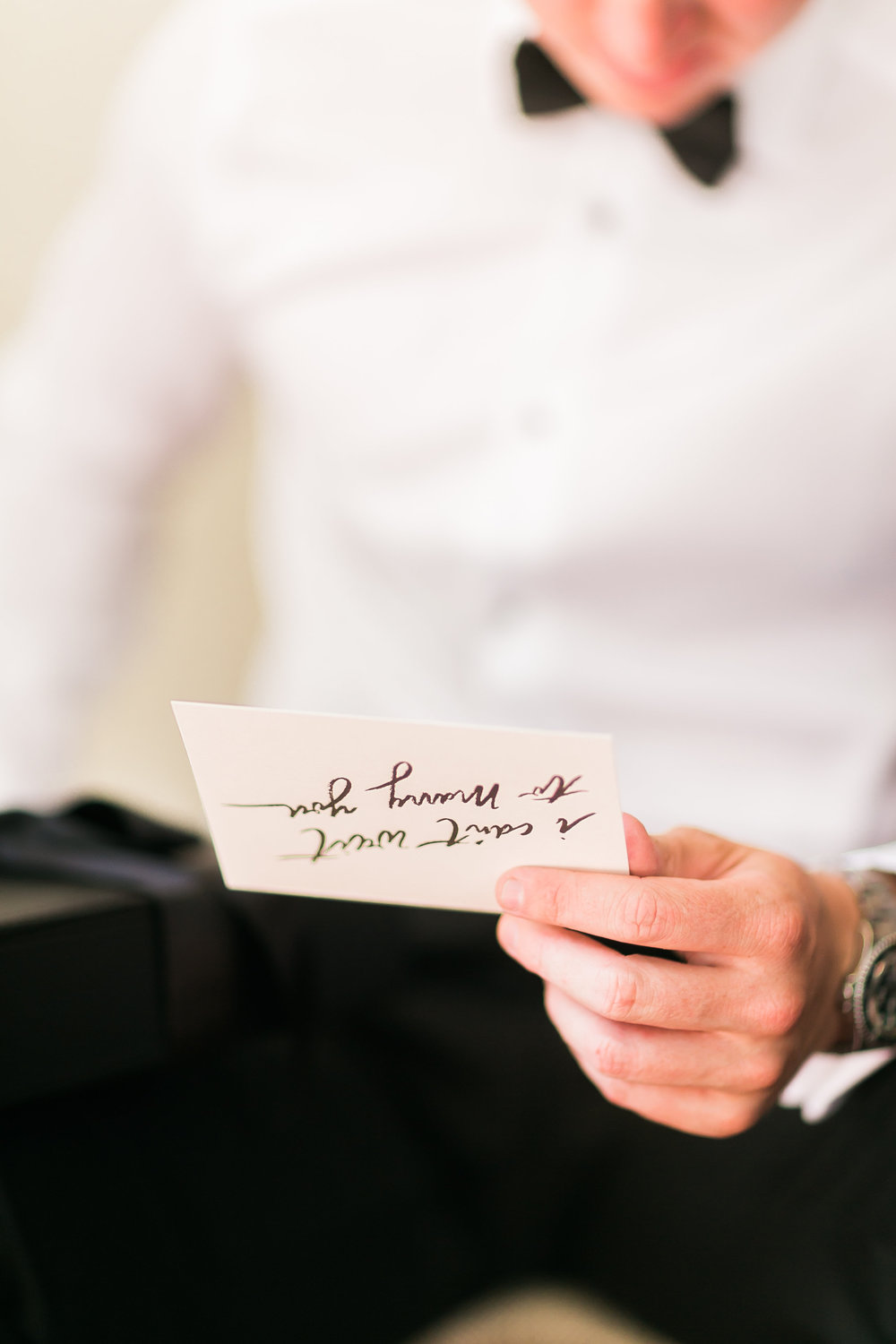 Groom reading a card from the bride.   CREDITS:  Destination Wedding Planner  ANDREA EPPOLITO EVENTS  · Images by  J.ANNE P  HOTOGRAPHY  · Video  HOO FILMS  · Venue Ritz Carlton Bacara Santa Barbara ·Gown  MONIQUE LHULLIER ·Bridesmaids Dresses  SHOW ME YOUR MUMU ·Stationery  SHE PAPERIE ·Bride's Shoes  BADGLEY MISCHKA ·Hair and Makeup  TEAM HAIR AND MAKEUP · Floral  BLUE MAGNOLIA ·Linen  LA TAVOLA ·Decor Rentals  TENT MERCHANT ·Calligraphy  EBB ·Lighting  FIVE STAR AV ·Ice Cream Station  MCCONNELL'S ICE CREAM