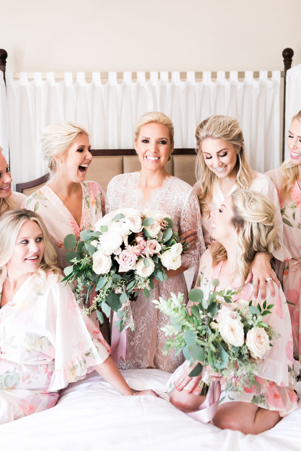 Bridesmaids in robes with with Bouquets.    CREDITS:  Destination Wedding Planner  ANDREA EPPOLITO EVENTS   ·  Images by  J.ANNE P  HOTOGRAPHY   ·  Video  HOO FILMS   ·  Venue Ritz Carlton Bacara Santa Barbara  · Gown  MONIQUE LHULLIER  · Bridesmaids Dresses  SHOW ME YOUR MUMU  · Stationery  SHE PAPERIE  · Bride's Shoes  BADGLEY MISCHKA  · Hair and Makeup  TEAM HAIR AND MAKEUP  · Floral  BLUE MAGNOLIA  · Linen  LA TAVOLA  · Decor Rentals  TENT MERCHANT  · Calligraphy  EBB  ·Lighting  FIVE STAR AV  · Ice Cream Station  MCCONNELL'S ICE CREAM