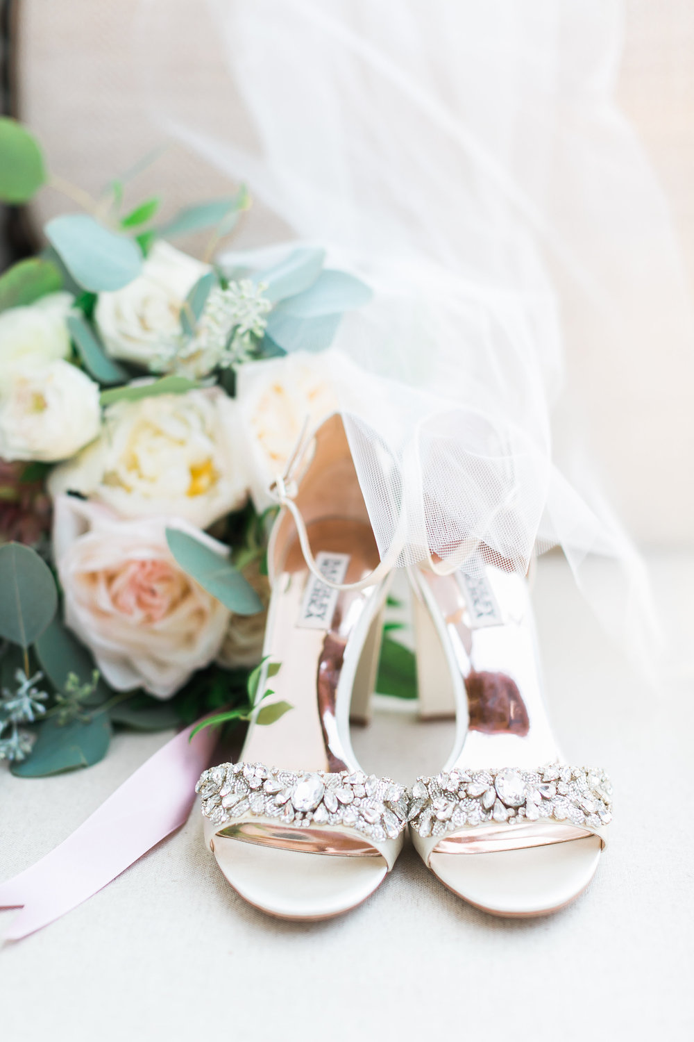 Champagne Badgley Mischka Wedding Shoes.    CREDITS:  Destination Wedding Planner  ANDREA EPPOLITO EVENTS   ·  Images by  J.ANNE P  HOTOGRAPHY   ·  Video  HOO FILMS   ·  Venue Ritz Carlton Bacara Santa Barbara  · Gown  MONIQUE LHULLIER  · Bridesmaids Dresses  SHOW ME YOUR MUMU  · Stationery  SHE PAPERIE  · Bride's Shoes  BADGLEY MISCHKA  · Hair and Makeup  TEAM HAIR AND MAKEUP  · Floral  BLUE MAGNOLIA  · Linen  LA TAVOLA  · Decor Rentals  TENT MERCHANT  · Calligraphy  EBB  ·Lighting  FIVE STAR AV  · Ice Cream Station  MCCONNELL'S ICE CREAM
