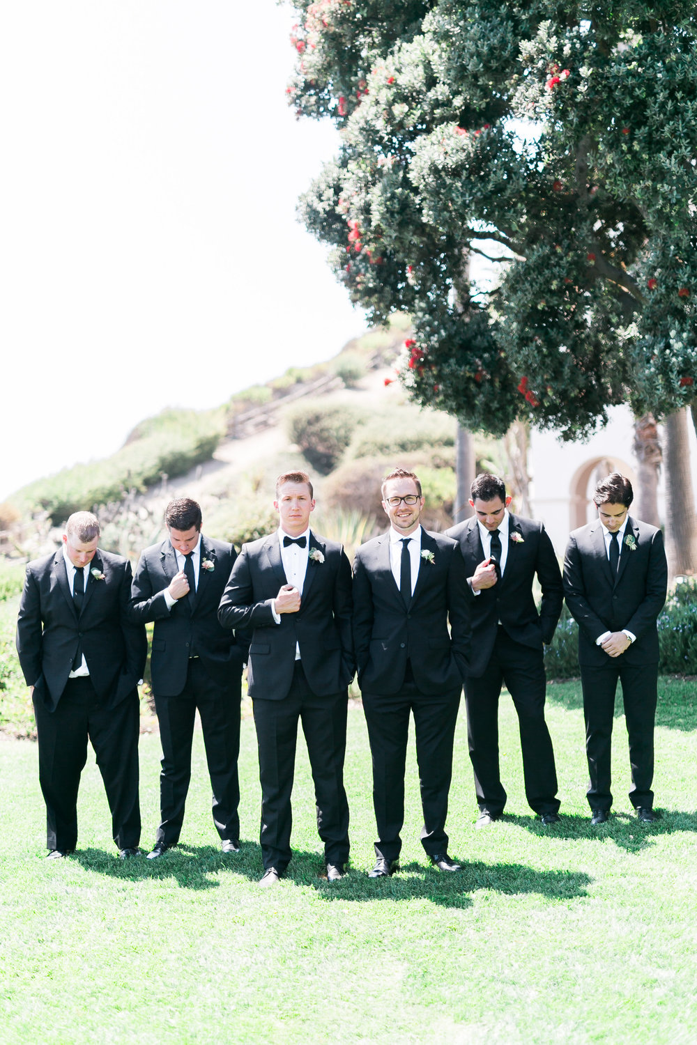 Groomsmen at The Bacara Santa Barbara.   CREDITS:  Destination Wedding Planner  ANDREA EPPOLITO EVENTS  · Images by  J.ANNE P  HOTOGRAPHY  · Video  HOO FILMS  · Venue Ritz Carlton Bacara Santa Barbara ·Gown  MONIQUE LHULLIER ·Bridesmaids Dresses  SHOW ME YOUR MUMU ·Stationery  SHE PAPERIE ·Bride's Shoes  BADGLEY MISCHKA ·Hair and Makeup  TEAM HAIR AND MAKEUP · Floral  BLUE MAGNOLIA ·Linen  LA TAVOLA ·Decor Rentals  TENT MERCHANT ·Calligraphy  EBB ·Lighting  FIVE STAR AV ·Ice Cream Station  MCCONNELL'S ICE CREAM